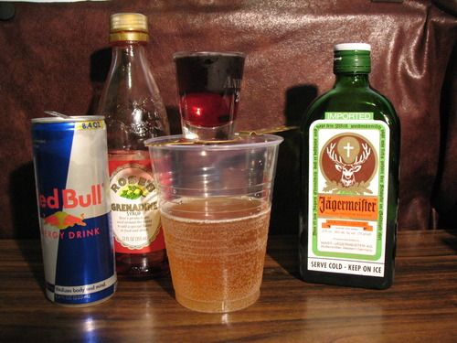 .75 oz Grenadine .75 oz Jagermeister 8 oz (or to taste) Red Bull   Directions: Pour the grenadine into a shot glass, and layer the Jagermeister on top. Drop into a cup of Red Bull. Chug. Kill titans.