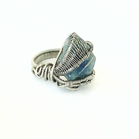 Check out this item in my Etsy shop https://www.etsy.com/ca/listing/549788277/raw-sapphire-ring-wire-wrapped-ring