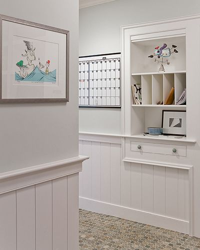 Boston architect David Sharff used wainscoting very effectively in the bright and airy way with his Waldon Court Home project. GREAT way to organize the mail and keep it from overtaking other parts of the house... and keep it by the door for the mailbox.