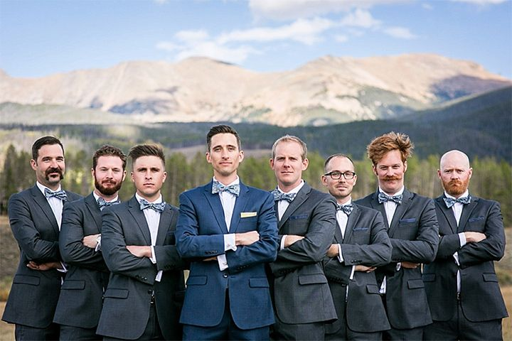 Love the groom in blue and the groomsmen in grey and all with patterned bowties! ~ we ❤ this! moncheribridals.com