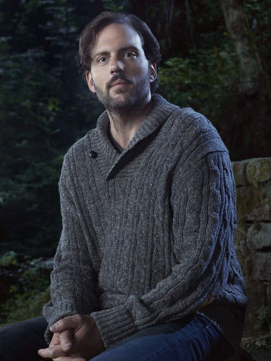 Monroe from Grimm I find him hot hot hot. I dunno - maybe it's the grandpa sweaters? Probably just his characters awesome sense of humor.