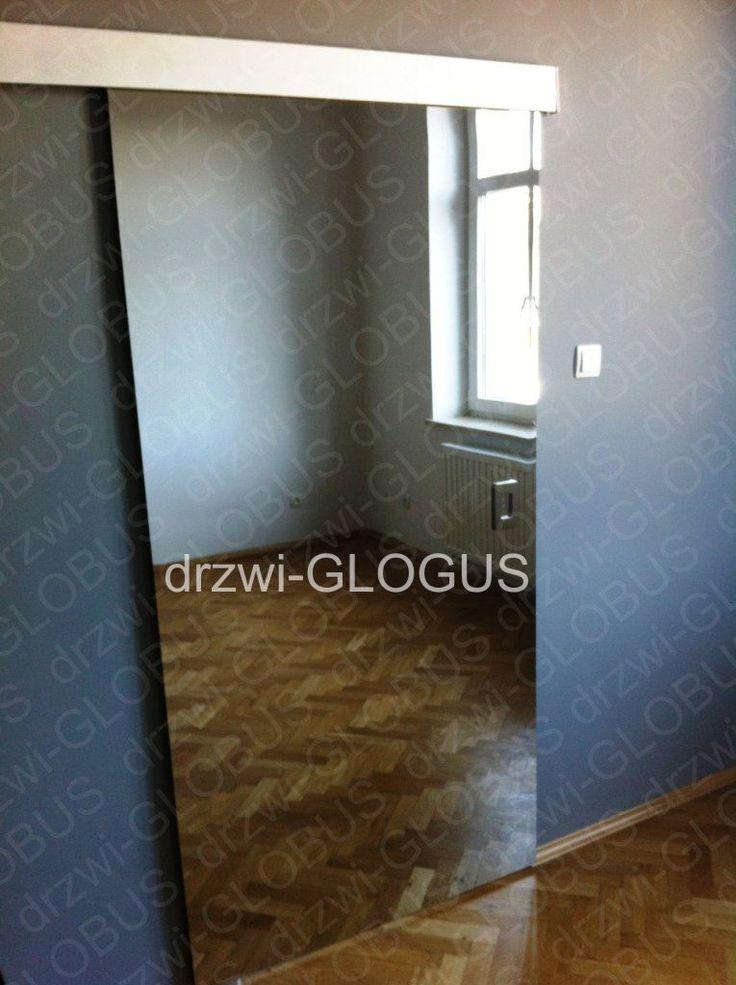 Znalezione obrazy dla zapytania drzwi przesuwne wewnętrzne z lustrem