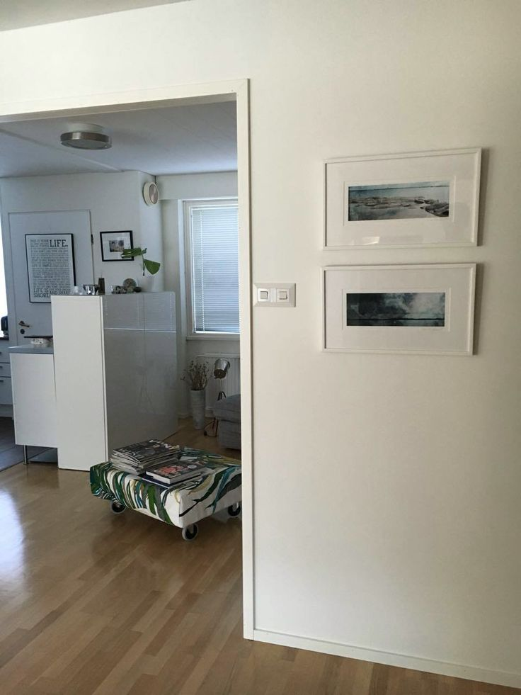 Two of lighthouse island sceneries by Päivi Hintsanen in their new home. Photo by Anna G.