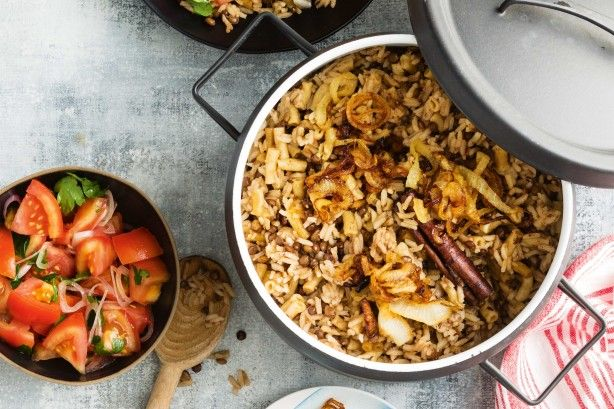 Koshari is a classic Egyptian dish made from rice, lentils and pasta. It's often served by street vendors and is prepared in large pots.