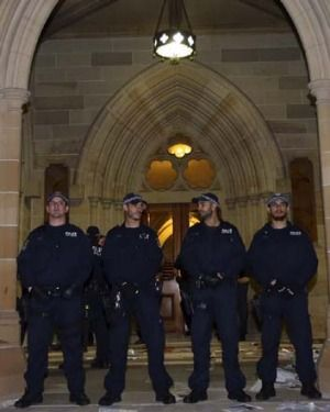 Police guard an entrance to St John's College as protesters await Christopher Pyne's arrival. Christopher Pyne smuggled past students at University of Sydney