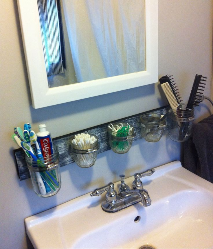 i love the use of mason jars as a sink countertop organizer what a great way to keep a small bathroom clutter free this would be a great diy project for