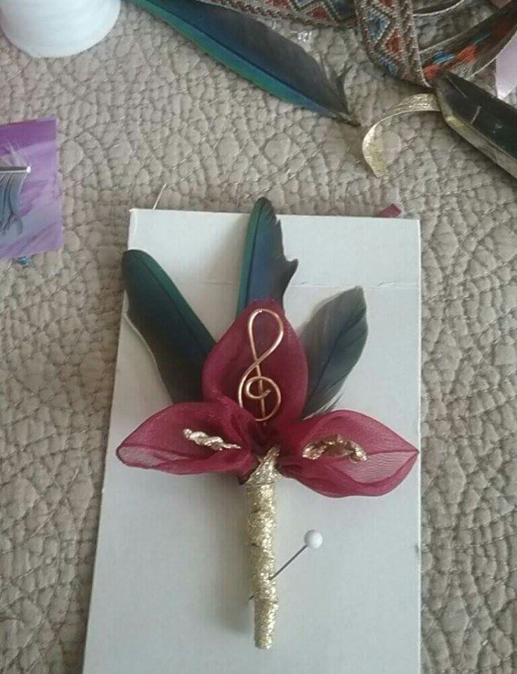 Boutiner I made with ribbon and parrot feathers.