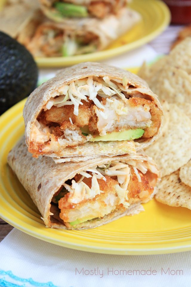 Baked butterfly and popcorn shrimp are combined to create this incredibly #delicious Spicy Sriracha Shrimp Wrap.