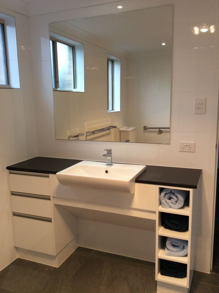 New plumbing for the wheelchair friendly vanity in this bathroom renovation. www.connectedplumbgas.com.au