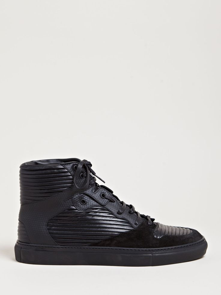 Clean. (Balmain Denim x Balenciaga Men's Hi-Top Raised Leather Trainers from SS13 collection in black.($575)).