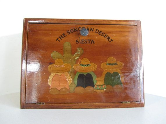 """A southwestern folky piece that is hand painted and hand crafted. A wooden bread box with a """"Sonoran Desert Siesta"""" scene. Kitsch and adorable."""