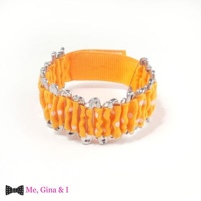 Orange dot safety pin bracelet.