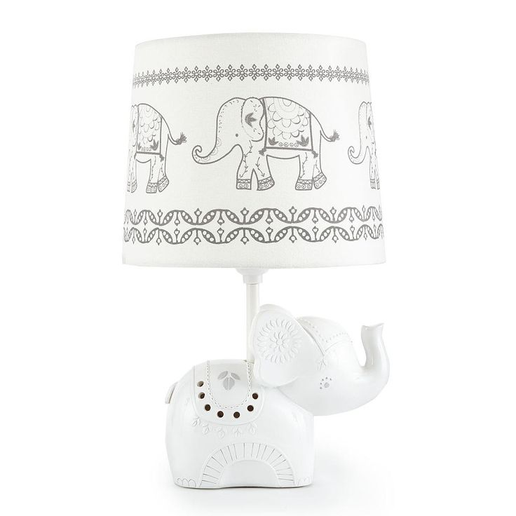 The Baby Ely Lamp Base and Shade features a beautiful elephant lamp base with painted accents and detailed features. The matching lamp shade is a grey and white trail of elephants printed on a fabric shade. This lamp will brighten up the room while adding a decorative accent to your nursery.