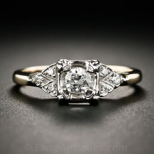 "Found on LangAntiques $1,250  ""This 1950s vintage diamond engagement ring, crafted in two-tone yellow and white gold, glistens with a bright-white, transitional round brilliant-cut diamond, weighing one-fifth-of-a-carat, but which presents significantly larger due to its illusion setting. The diamond is embellished on each side with a twinkling trio of single-cut diamonds set in a triangular arrangement. A very lovely traditional vintage engagement ring."""