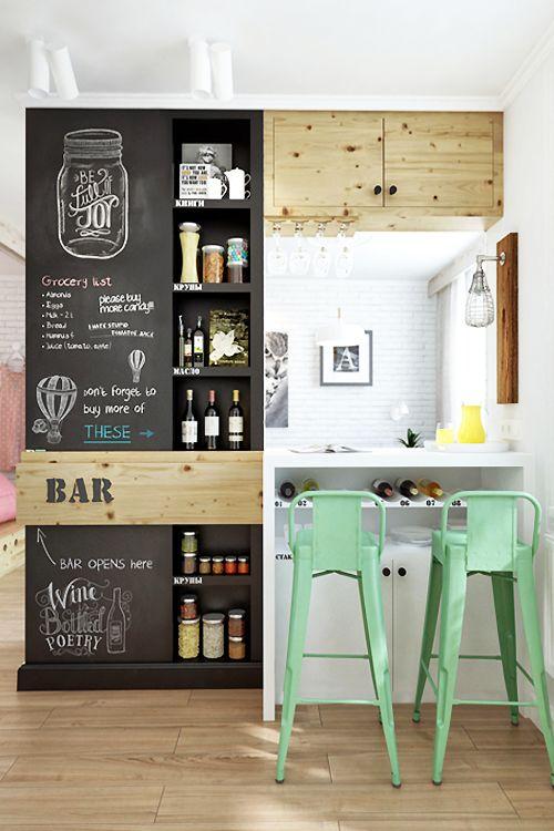Fresh modern kitchen design with wooden floor mint alluminium tolix chairs and chalk board