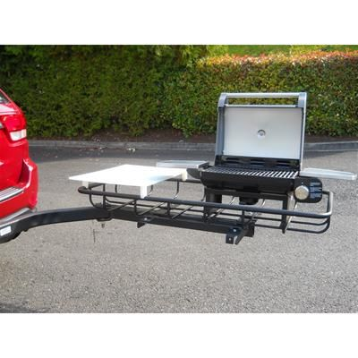 The Hitch Grill Station from StowAway comes with a Cuisinart Grill, jumbo cutting board, and largo cargo rack.