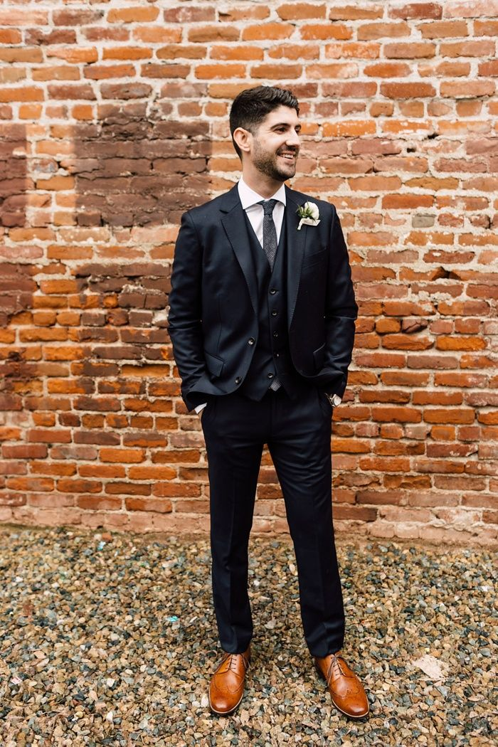 Groom style: black suit, brown leather shoes | Image by Plum & Oak Photo