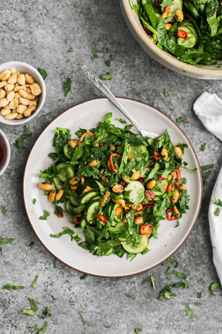 A fast peanut salad that uses fresh English cucumbers along with spinach, red peppers, toasted peanuts, and an easy peanut dressing.