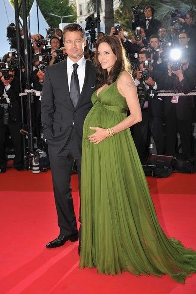 Pregnant Angelina Jolie in a realistic glowing ensemble