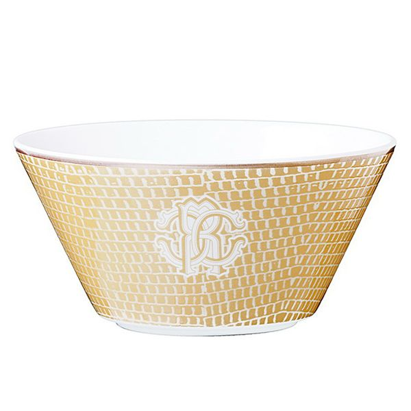 LIZZARD GOLD FRUIT BOWL from Roberto Cavalli Lizzard Gold Tableware collection. Pair it with the other Lizzard Gold tableware items to be the perfect host. All tableware made with fine bone China. This product arrives tastefully packaged in an authentic Roberto Cavalli luxury box.