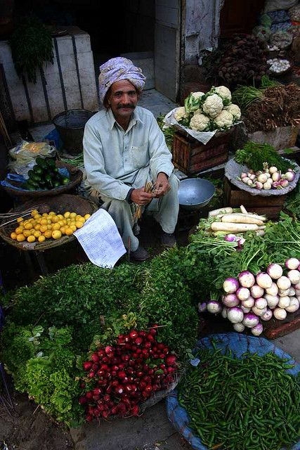 A greengrocer sells his produce, Pakistan. Image: babasteve, via Flickr