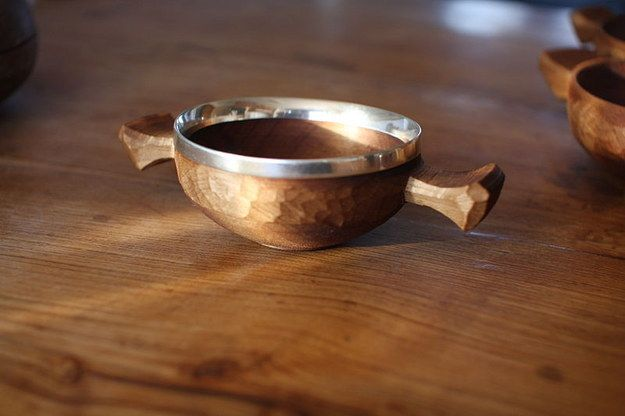 Seal your union by drinking from a quaich.~~~A quaich is a traditional two-handled drinking cup, usually made from wood held together with bands of silver. Simultaneously drinking from the quaich during your ceremony is a great way to symbolise your commitment to one another.