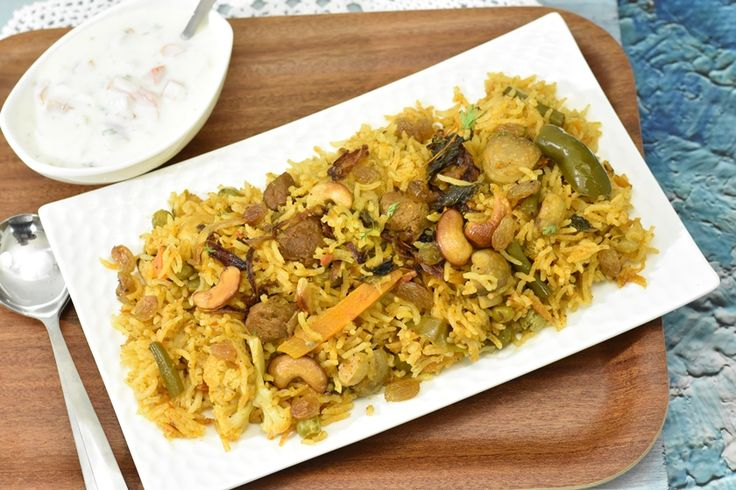 Vegetable biryani recipe features an assortment of fresh veggies & soy chunks cooked with whole & ground spices, fragrant basmati rice, saffron, & ghee.
