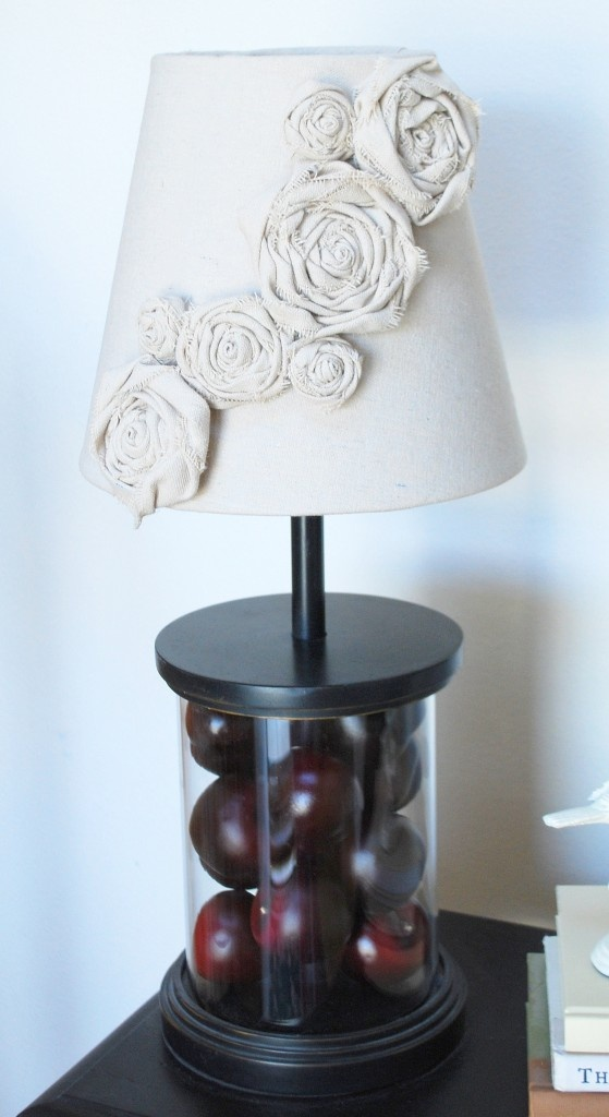 The link goes to DIY Lampshade Makeover with Canvas Rosettes. But I see a temari display idea!