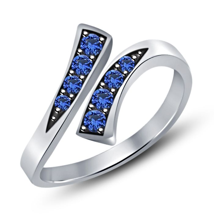 This chic, dainty toe ring features alternating Blue Sapphire stones Prong-set in solid 925 sterling silver. The Ring has an open bypass design, allowing you to adjust its size for the right fit. It has Platinum Finish to keep it looking shiny.    Item    Specification  Metal    Sterling Silver  Main Stone    Sapphire  Stone Color    Blue  No of Stone    08 Type    Toe Ring  Style    Bypass  Ring Size    Adjustable