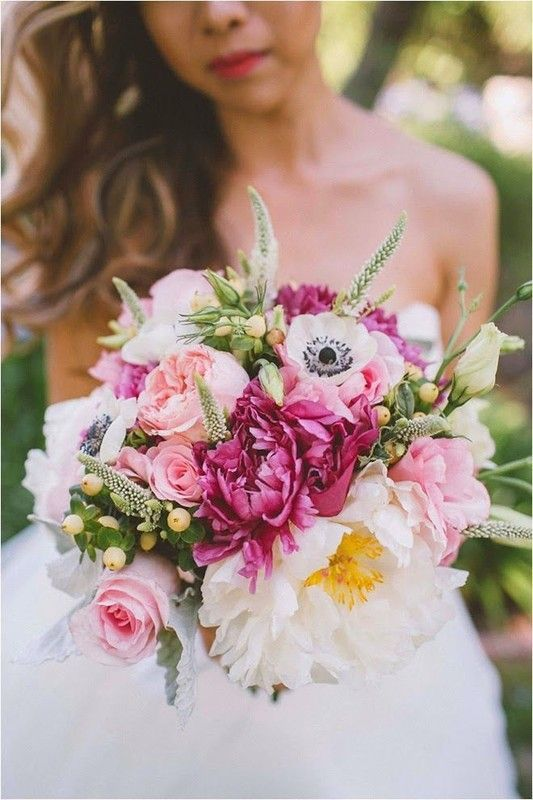 Modern pink, white and raspberry-coloured wedding bouquet