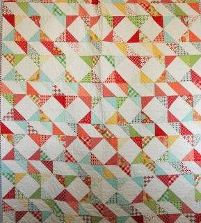 This is a very pretty cottage feeling quilt in pretty corals, greens and yellows. Perfect for a summer afternoon nap!
