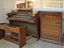 Hammond Organ-- is an electric organ, invented by Laurens Hammond and John M. Hanert and first manufactured in 1935. Various models have been produced, most of which use sliding drawbars to create a variety of sounds. Until 1975, Hammond organs generated sound by creating an electric current from rotating a metal tonewheel near an electromagnetic pickup, and then strengthening the signal with an amplifier so that it can drive a speaker cabinet.