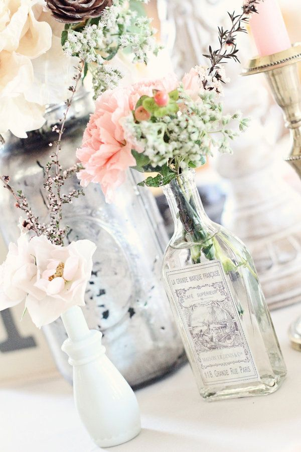 antique bottles and milk glass together create the perfect vintage wedding decorations. Just to few flowers, touch of silver and lace..