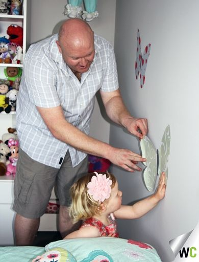 Lee spent some quality time with his daughter Elise while installing a Wallcreations Butterfly Decal.