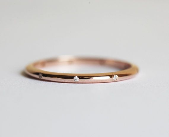 9-Diamond Band in 14k rose gold. Elegant and simple ring in 14k gold, white gold, rose gold with tiny diamonds. It is designed for those who love