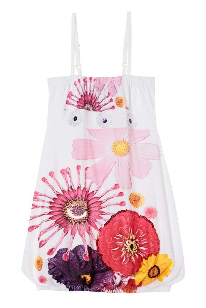 Siluetas globo. Las claves de su armario: cuellos bebé, prints de flores y vestidos globo. En la imagen vestido modelo Albense.