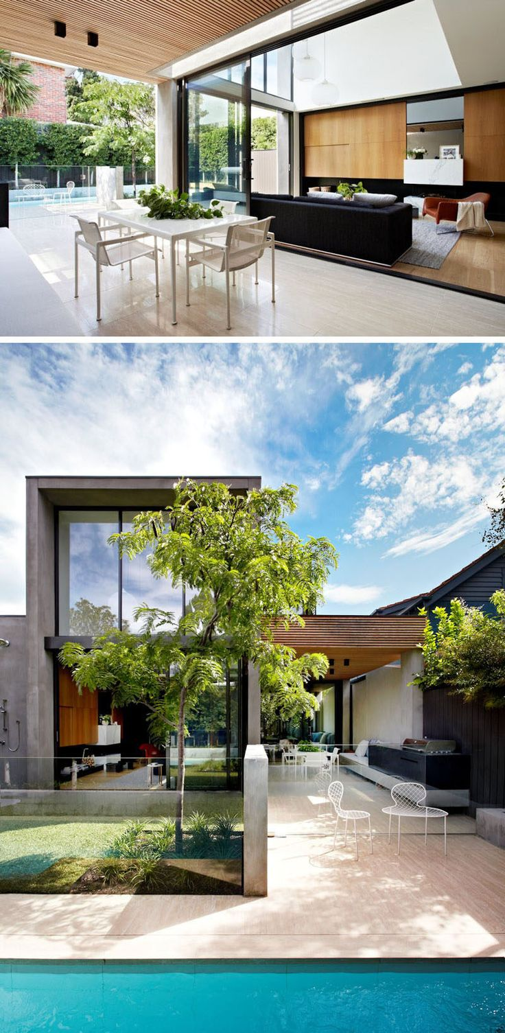 23 Awesome Australian Homes That Perfect Indoor / Outdoor Living // The living room of this home has glass doors that open up to a covered dining area with seating and a built-in BBQ.