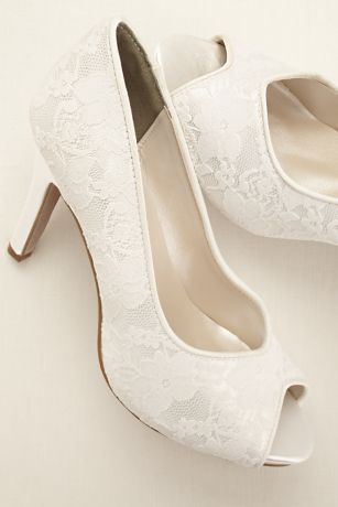 "Elegant and timeless, these dyeable lace platform peep toe pumps are the perfect choice for your big day!  Dyeable shoes are sold in White as shown.  To receive shoes Dyed in one of our 40 Exclusive David's Bridal Colors: Select color White and select the shoe size of your choice. Select the specific dyeable color option from the dropdown option below before proceeding to checkout. To receive shoes in White: Select color White, select the shoe size of your choice, and click the ""Order…"
