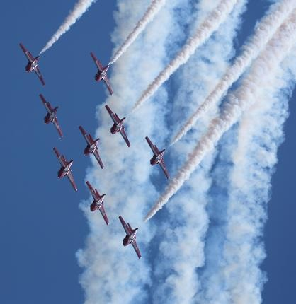 Canadian Forces Snowbirds ,431 Squadron Air Demonstration Team, from Moose Jaw, Sask., loop in Big Arrow formation over the Comox Valley. CF Photo by MCpl Robert Bottrill