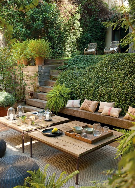 Green garden design....SO nice for a sloped area.  Great little tables, too.