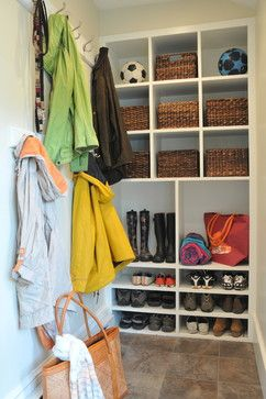 Mudrooms Design Ideas, Pictures, Remodel and Decor I like the full wall for shoes, boots, and baskets, and a full wall for coats, all tucked into a corner. Would need a bit of seating, otherwise, perfect.