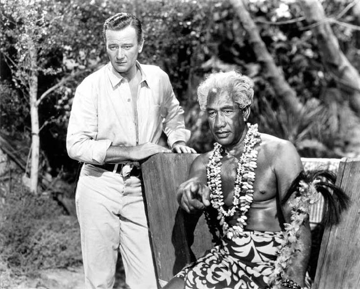 """Duke Kahanamoku with """"The Duke"""" John Wayne.  They were good friends and shared a common love of the ocean.  Duke starred (along with other famous surfers) in an excellent movie about the history of surfing by Jack McCoy, called """"A Deeper Shade of Blue""""!  Worth watching!"""