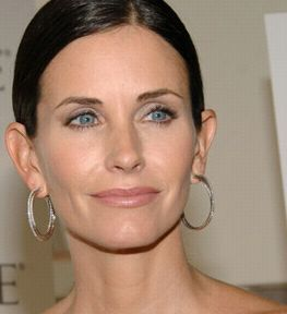 9b3f93fd532 Courteney Cox wearing David Yurman Silver Ice Crossover Hoop Earrings