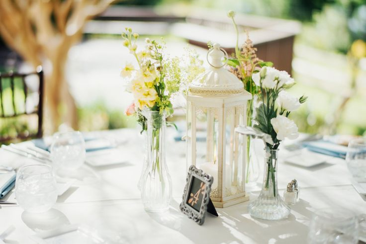 lantern and bud vase centerpieces- with your flowers and colors, with gray lantern
