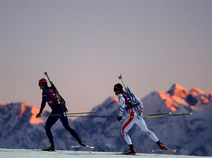 Biathletes Lars Berger (L) of Norway and Martin Fourcade of France in training ahead of the Sochi 2014 Winter Olympics at the Laura Cross-Country Ski and Biathlon Center