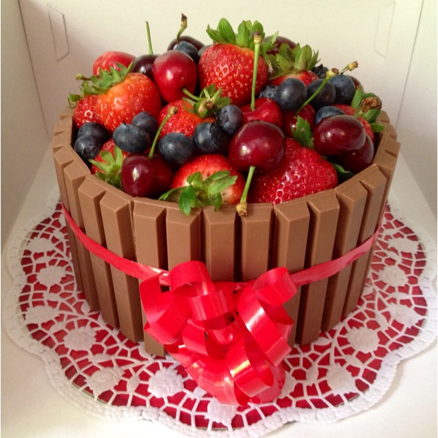 Chocolate cake with fresh fruit and KitKat                                                                                                                                                      More