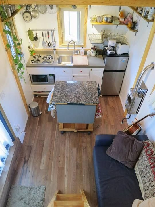Tiny house interior. The only thing I dont like about this house is the microwave.