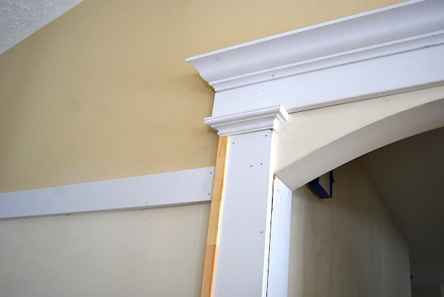 Arched doorway decor pinterest arch doorway and trim for Decorative archway mouldings