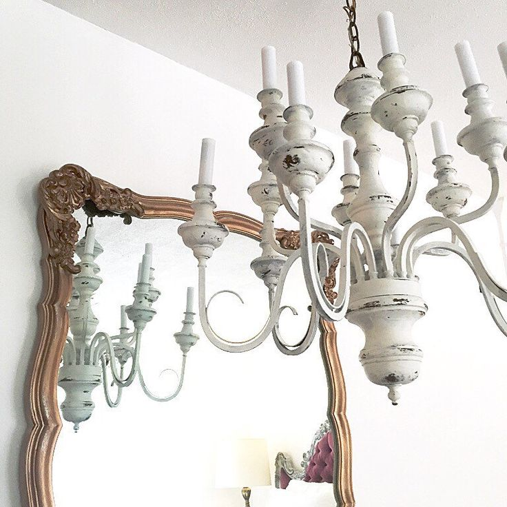 A personal favorite from my Etsy shop https://www.etsy.com/listing/233677272/white-distressed-chandelier-hanging