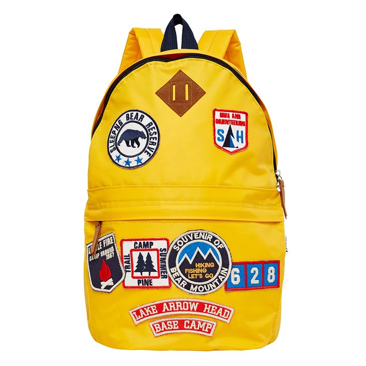 Boys backpack featuring camping themed cloth patches. Width 33cm x Height 43cm.